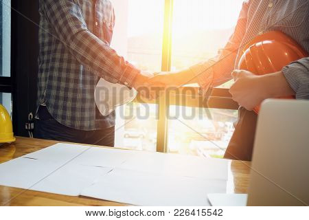 Business Handshake Executives To Congratulate The Join Business Agreement.concept For Architect Or E
