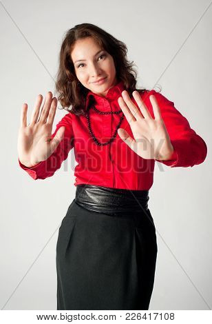 Serious Young Woman Showing Stop Gesture Over White Background