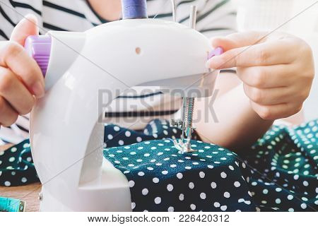 Woman's Hand On Sewing Machine.dressmaker Work On The Sewing Machine.tailor Making A Garment In Work