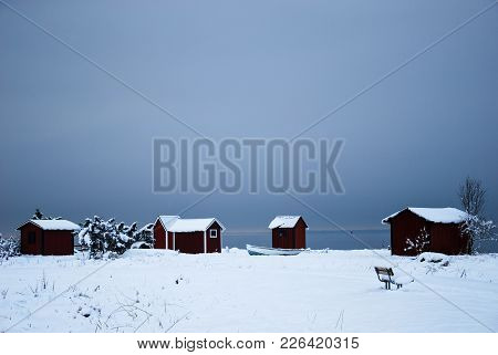 Snowy Old Fishing Cabins On The Swedish Island Oland In The Baltic Sea