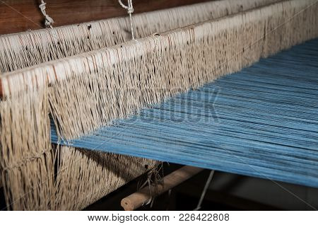 Standing In The Museum Old Wooden Weaving Tool With Blue And White Threads For Creating A Fabric