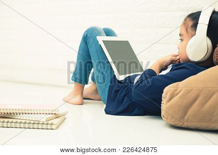 Wireless Router And Kids Using A Tablet In Home. Router Wireless Broadband Home Laptop Computer Phon
