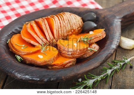 Homemade Cooked Sweet Potato With Spices And Herbs In Wooden Plate