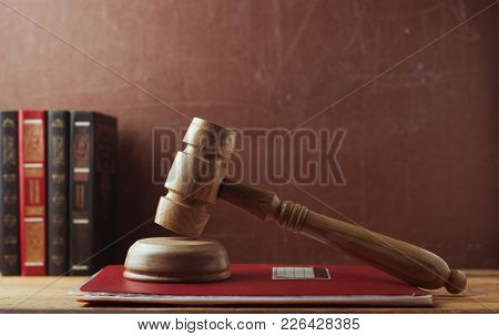 The Concept Of The Law-old Wooden Hammer Referee, Red Folder With A Verdict. Old Book. Judicial Prac