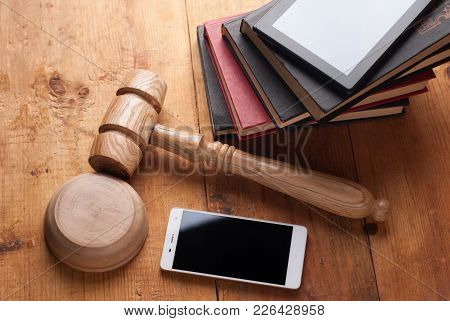 2913015 Smartphone, The Judge's Gavel On Wooden Background.