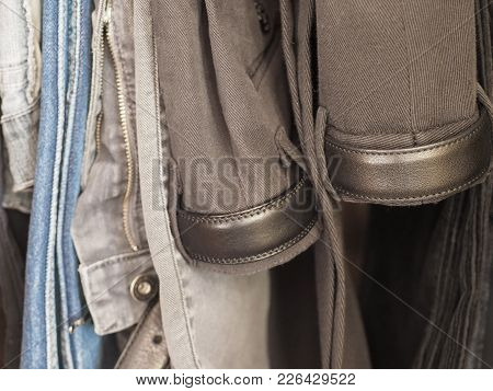 Many Male Trousers Hanging In A Closet