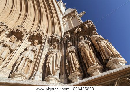 Tarragona,spain-november 7,2011: Architecture, Religious Building,cathedral,main Entrance, Figures A