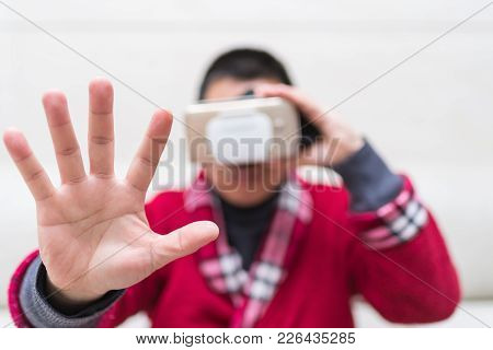 Man Wearing Vr Glasses Or Virtual Reality Headset With His Hand Feeling The Simulation At Home World