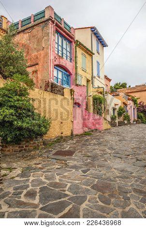 Collioure,france- June 17,2011:street Colored Facade Houses, Collioure In Cote Vermeille Coast.franc