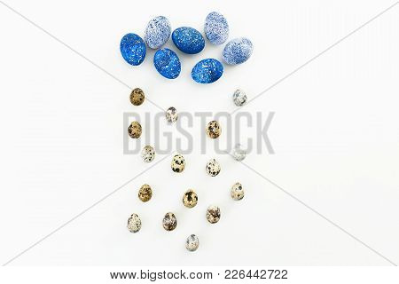 Speckled Easter Egg With Quail Eggs On White Background. Flat Lay. Top View. Creative Concept