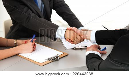 Close-up Image Of A Firm Handshake Standing For A Trusted Partnership.