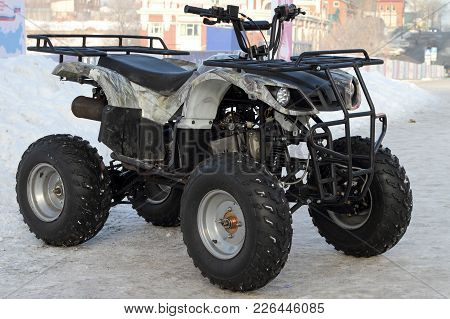 Perm, Russia - February 10, 2018: Modern Atv Stands Near The Ice Town On The Street Of The City Of P