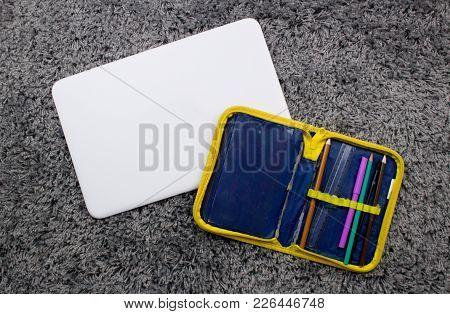 Old Damaged School Pencil Case And A Modern Notebook.next Level.school Versus Employment. Next Level