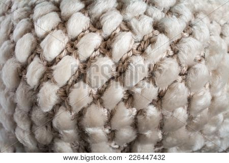 Convex Pattern Of Structure Of Cloth Knitting From Yarn And Natural Sheep Fur.