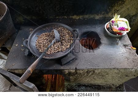 Roasting Of Coffee Beans In Traditional Way. Up View