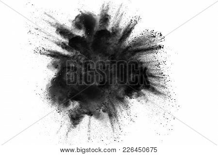 Black Powder Explosion Against White Background.the Particles Of Charcoal Splatted On White Backgrou