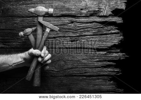 Bouquet Of Hummer Tools As Gift Against Wooden Background. Industrial Concept. Black And White.