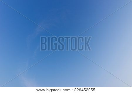 Transparent blue sky with clouds and atmospheric afternoon.