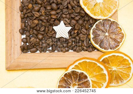 Wooden Photo Frame Filled With Coffee Beans And A Decorative Star On The Table With Orange Slices, T