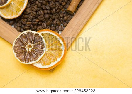 Wooden Photo Frame Filled With Coffee Beans, Cinnamon Sticks And Orange Slices, Top View Close Up, C