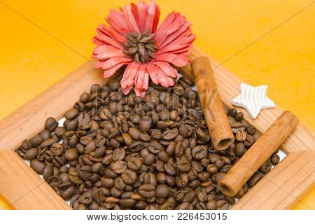 Wooden Photo Frame Filled With Coffee Beans And Decorated With, Orange Slices, A Red Flower And A De