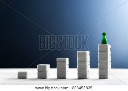 Success In Business, Reaching Goals, Leading And Being The Best Concept. Climbing And Standing On Th