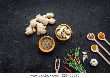 Condiments, Seasoning And Spices Concept. Dry Spices In Wooden Spoons Near Ginger, Rosemary, Chili P