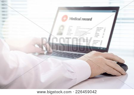 Doctor Using Laptop And Electronic Medical Record (emr) System. Digital Database Of Patient's Health