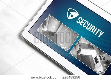 Home Security System And Application In Tablet. Protection And Surveillance Camera Live Footage Insi