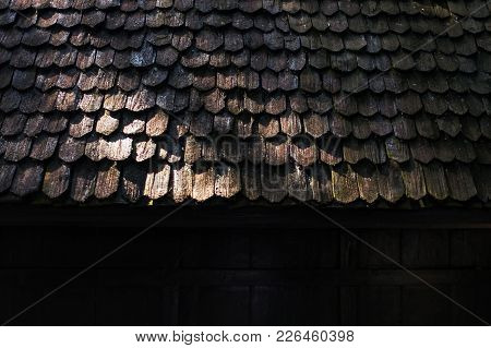 Old Wooden Tile Roof In Thailand. Traditional House Conctruction In Asia