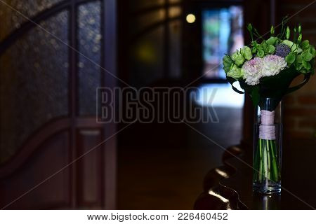 Flowers In Glass Vase On Table In Room. Floral Decoration, Decor. Bunch Of Flowers, Bouquet. Room In
