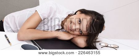 Closeup. Tired Young Business Woman Sleeping , Sitting At Your Desk.photo With Copy Space