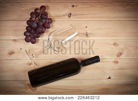 Bottle Of Wine,  Wineglass And Grape On Wooden Background
