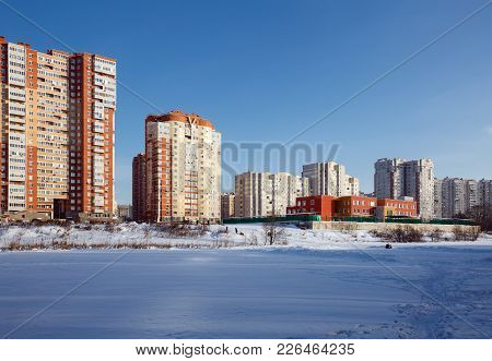View Of The New Residential District With Kindergarten On The Banks Of The River Pekhorka In Winter.