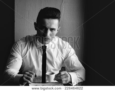 Man Young Handsome Elegant Model Wears White Shirt Black Skinny Necktie Sits At Table Holds Cup Of C