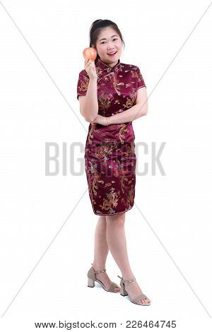 Portrait Of Asian Woman In Traditional Chinese Long Dress, Cheongsam, Holding Apple With Eating Acti