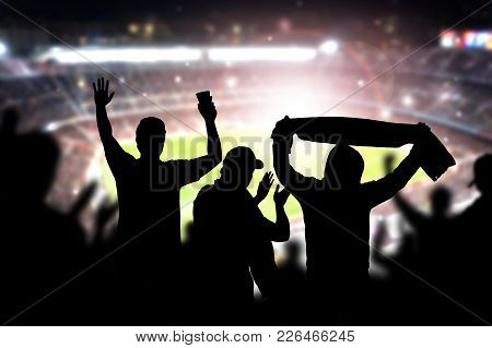 Friends At Football Game In Soccer Stadium. Crowd Cheering And Celebrating A Goal In Arena During Ma