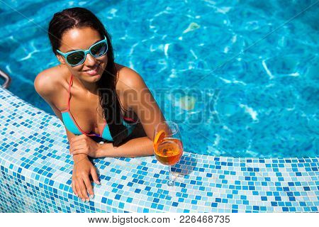 Woman Relaxing On The Swimming Pool Water In Hot Sunny Day. Summer Holiday Idyllic.