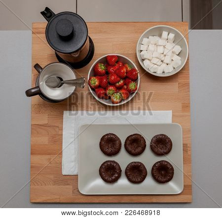 Served Mini Chocolate Brownie With Tea And Strawberry.