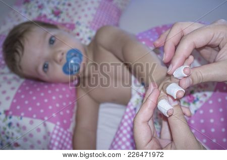 Baby Boy Shows His Bandaged Fingers Before Suffering A Domestic Accident. Domestic Accidents Concept