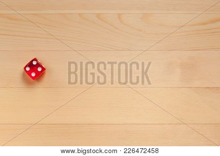 Red Dice On A Light Brown Wooden Background. Discarded 5