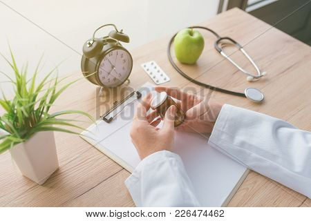 Female Doctor Holding Unlabeled Bottle Of Various Pills And Medication, Generic Drugs Concept, Presc