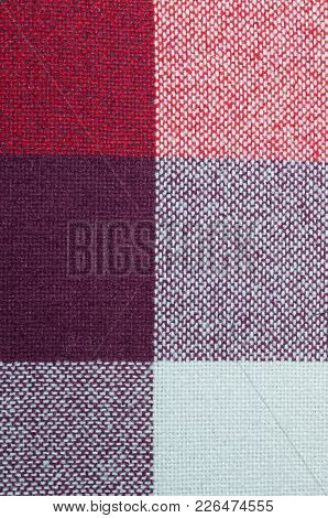 Textured Fabric With A Pattern Of Squares Of Shades Of Red And Purple