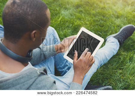 Male Hands With Digital Tablet Closeup, Over Shoulder Shot. African-american Student Working On Devi