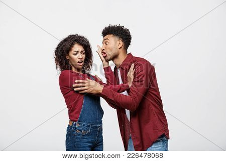 Close-up Of African American Young Couple Deny Kissing Over White Background Studio.