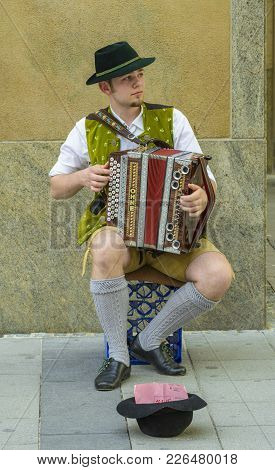 Unidentified Street Performer, Dressed In Traditional Bavarian Clothes, Sing To Accordion At A Stree