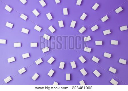 White Sugar Cubes On Purple Background. Top View