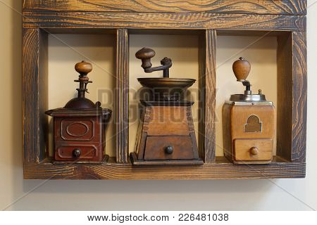 Coffee Grinders On Shelve. Retro Collection Of Coffee Grinders. Shop With Antiques.