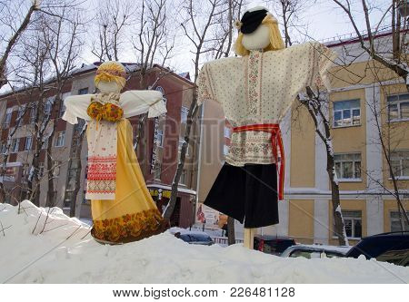 Murmansk, Russia - April 2, 2013: Rag Dolls Along The Street For A Holiday Maslenitsa