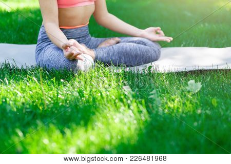 Fitness, Woman Yoga Relax Meditation In Lotus Pose Outdoors In The Park, Copy Space. Young Slim Girl
